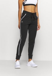 Under Armour - RIVAL TAPED PANT - Tracksuit bottoms - black - 0