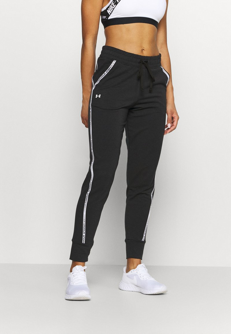Under Armour - RIVAL TAPED PANT - Tracksuit bottoms - black