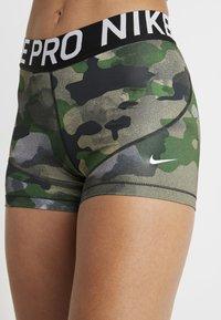Nike Performance - REBEL CAMO - Leggings - club gold/white - 4