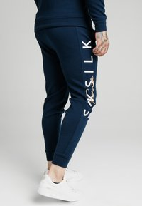 SIKSILK - SIGNATURE TRACK PANTS - Tracksuit bottoms - navy