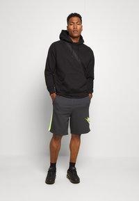 Nike Sportswear - FESTIVAL ALUMNI - Shorts - dark smoke grey/volt/volt - 0