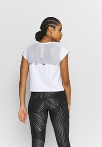 Puma - TRAIN TEE - T-Shirt basic - white - 2