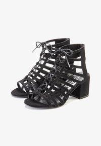 Ankle cuff sandals - schwarz