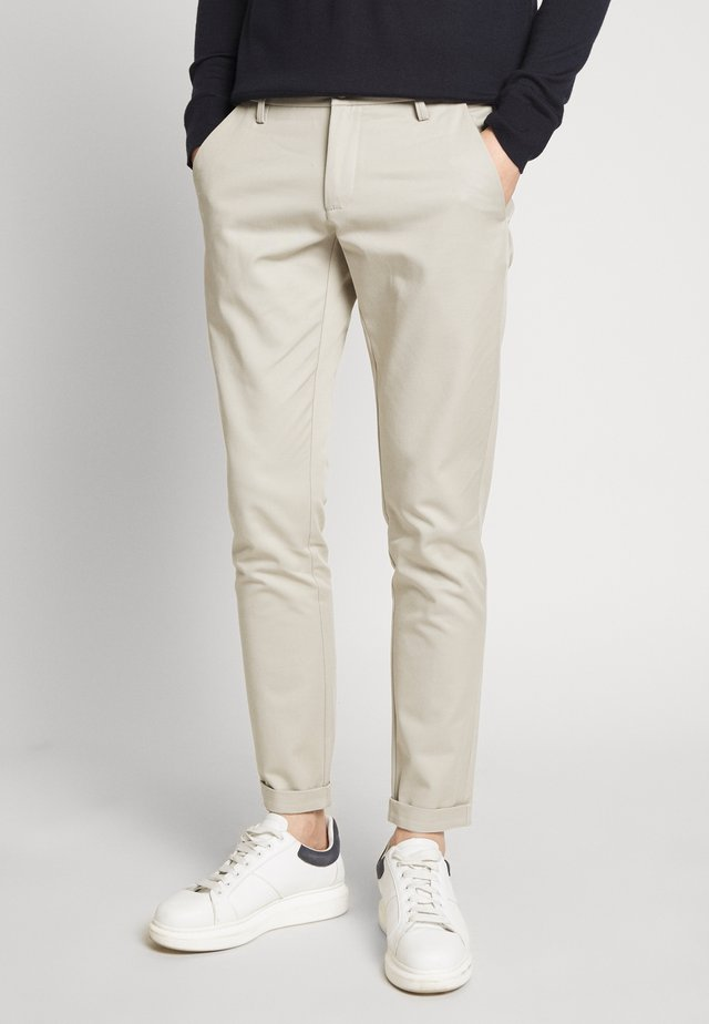 THOR SLIM - Trousers - sand