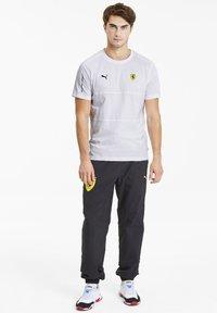 Puma - SCUDERIA FERRARI T7  - Print T-shirt -  white - 1