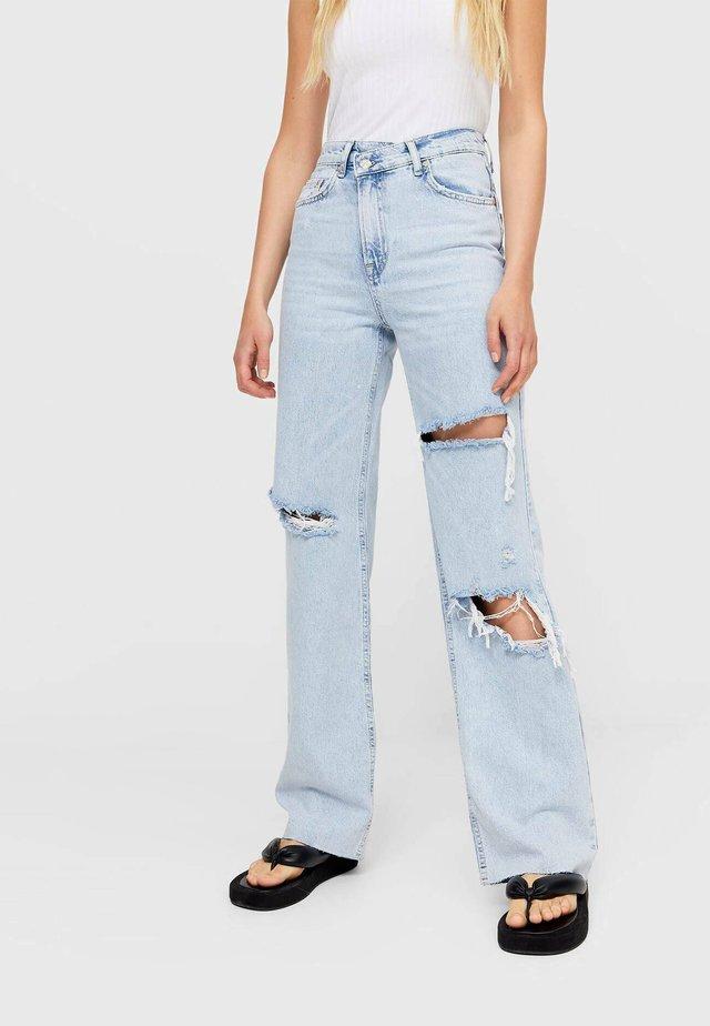 MIT ASYMMETRISCHEM BUND  - Jeans a sigaretta - light blue
