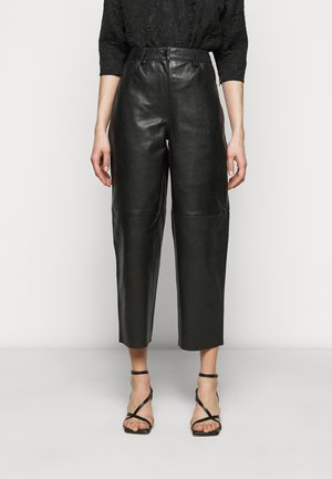 ASTON - Leather trousers - black