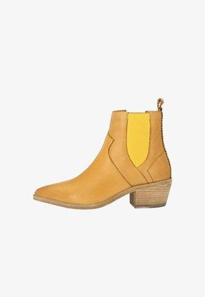 SANDRA - Cowboy/biker ankle boot - gelb