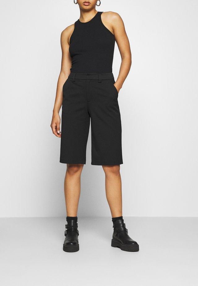 FAST SHORTS - Shorts - black