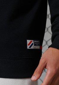Superdry - CITY COLLEGE - Sweatshirt - black - 1