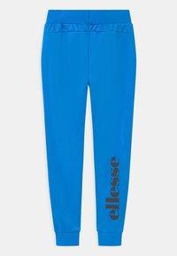 Ellesse - DESTRO UNISEX - Tracksuit bottoms - neon blue - 1