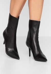 Lola Cruz - High heeled ankle boots - black - 0