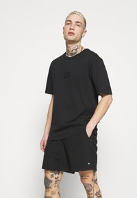 adidas Originals - BADGE UNISEX - T-Shirt basic - black - 3