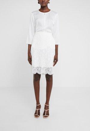 RIAMI - Pencil skirt - natural