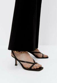 Uterqüe - Trousers - black - 3