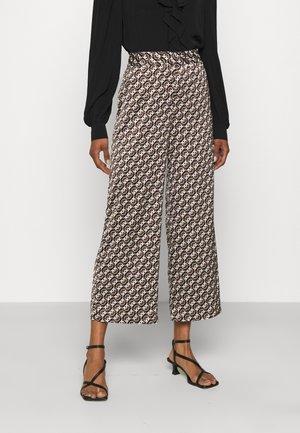 GRUS - Trousers - black