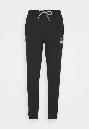 PUMA X MR DOODLE PANTS - Tracksuit bottoms - black