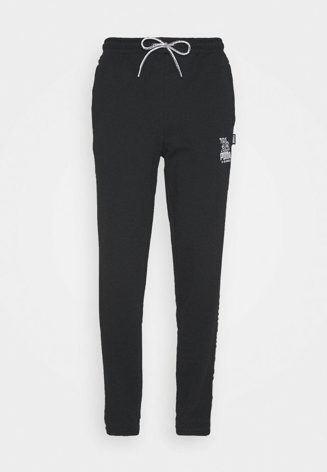 PUMA X MR DOODLE PANTS - Tracksuit bottoms - black