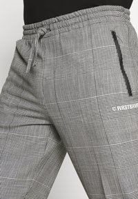 WRSTBHVR - SMART JOGGER - Kalhoty - black - 5