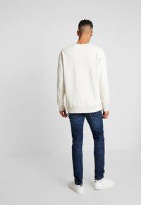 Scotch & Soda - TYE - Jeans Tapered Fit - icon blauw - 2