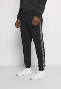 adidas Performance - ESSENTIALS TRAINING SPORTS PANTS - Jogginghose - black/white - 0