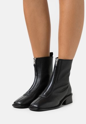 AMSTERDAM ZIP FRONT FLAT BOOT - Classic ankle boots - black