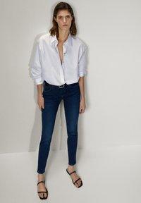 Massimo Dutti - MIT MITTELHOHEM BUND - Jeans Skinny Fit - blue - 1