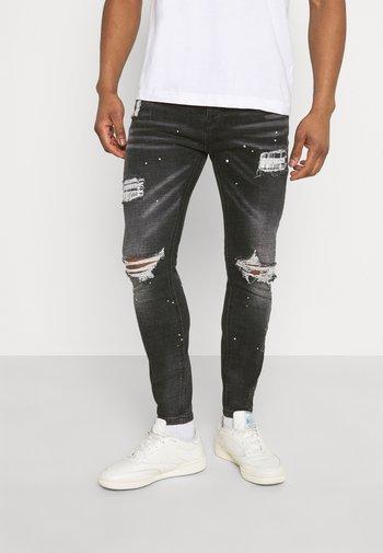 INWOOD CARROT - Jeans slim fit - jet black