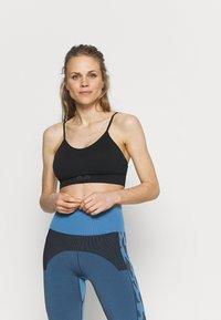 Ellesse - CERELIA BRA - Light support sports bra - black - 0