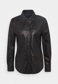 BABYDOLL - Button-down blouse - black