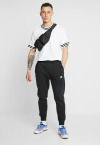 Nike Sportswear - CLUB - Tracksuit bottoms - black - 1