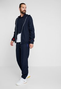 Lacoste Sport - Training jacket - navy blue/red/navy blue/white - 1
