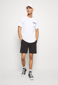 Calvin Klein Jeans - SIDE LOGO - Pantaloni sportivi - black - 1