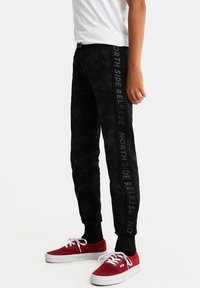 WE Fashion - Tracksuit bottoms - anthracite - 1