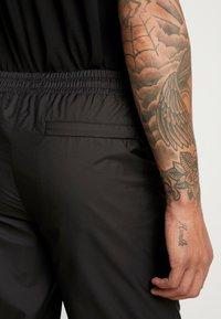 Puma - TREND PANTS - Tracksuit bottoms - black/houndstooth - 3