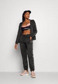 Champion - ELASTIC CUFF PANTS - Tracksuit bottoms - black - 1