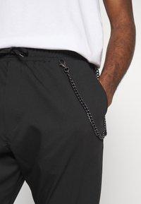 Gianni Lupo - PANTALACCIO - Trousers - black - 4