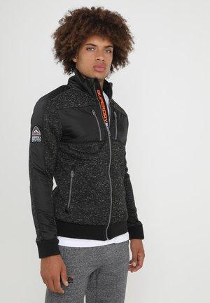 STORM TRACK TOP - Light jacket - gritty black