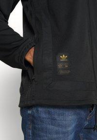 adidas Originals - WARMUP - Training jacket - black/goldmt - 5