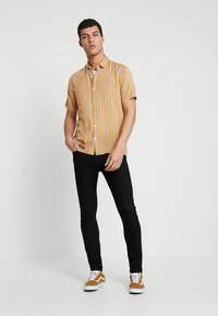 Levi's® - 519™ EXTREME SKINNY FIT - Jeans Skinny Fit - black denim - 1