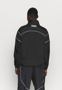 Nike Performance - FLY JACKET - Chaqueta de entrenamiento - black/white - 2