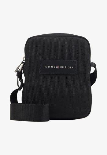 UPTOWN MINI REPORTER - Across body bag - black