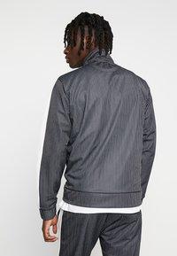 Night Addict - RAIN - Training jacket - black/white - 2
