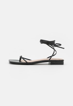 DOLLI - T-bar sandals - black