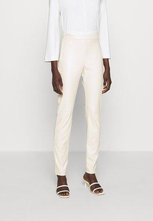 RANGHI - Leggings - Trousers - beige