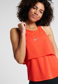 Nike Performance - TANK BREATHE - Sports shirt - bright crimson/reflective silver - 3