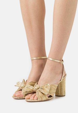 CAMELLIA KNOTWITH ANKLE STRAP - Sandály na vysokém podpatku - gold