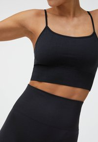 OYSHO - Light support sports bra - black - 0