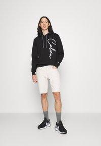 Calvin Klein - SUMMER SCRIPT LOGO HOODIE - Mikina - black - 1