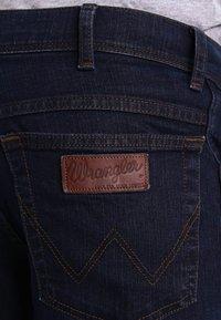 Wrangler - TEXAS STRETCH - Straight leg jeans - blue black - 4